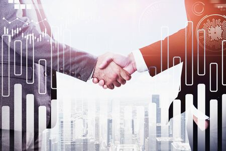 Close up of two businessmen shaking hands in modern city with double exposure of HUD infographic interface. Concept of hi tech startup and partnership. Toned image 写真素材