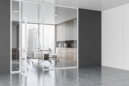 Office hall interior with white and gray walls, concrete floor and glass wall CEO office with comfortable computer desk and dark wooden bookcase with folders. 3d rendering Banco de Imagens