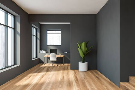 Interior of minimalistic home office with gray walls, wooden floor, compact computer table with white chair and bookshelf. 3d rendering