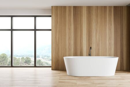 Interior of minimalistic spacious bathroom with wooden panel walls, wooden floor, window with beautiful view and comfortable bathtub. 3d rendering