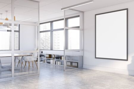 Corner of stylish office hall with white and glass walls, concrete floor, comfortable meeting room with wooden table and white chairs and vertical mock up poster frame. 3d rendering Banco de Imagens
