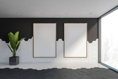 Interior of empty room with black and white tile walls, concrete floor, panoramic window and two vertical mock up poster frames. Concept of advertising. 3d rendering Stock fotó