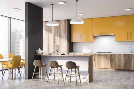 Corner of modern kitchen with white walls, wooden countertops, yellow cupboards, bar with stools and dining table with yellow chairs. 3d rendering Stock Photo