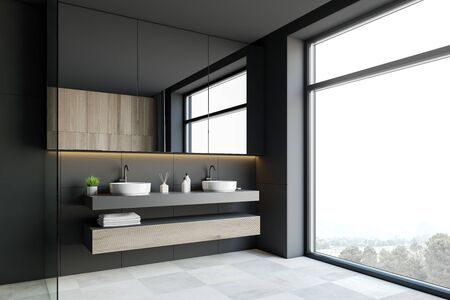 Corner of stylish hotel bathroom with dark grey walls, white tiled floor, double sink on wooden countertops and large mirror. 3d rendering Stock Photo