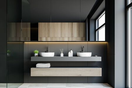 Interior of stylish hotel bathroom with dark grey walls, white tiled floor, double sink on wooden countertops and large mirror. 3d rendering