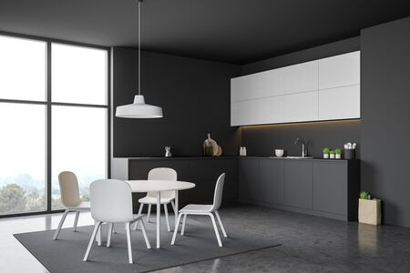 Corner of modern kitchen with gray and dark wooden walls, concrete floor, comfortable grey countertops, white cupboards and round dining table with chairs on carpet. 3d rendering
