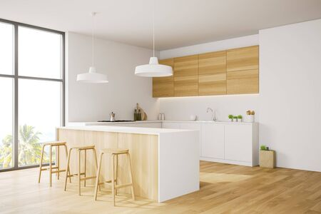 Corner of modern kitchen with white and wooden walls, wooden floor, comfortable white countertops, wooden cupboards and wooden bar with stools. 3d rendering Stock Photo
