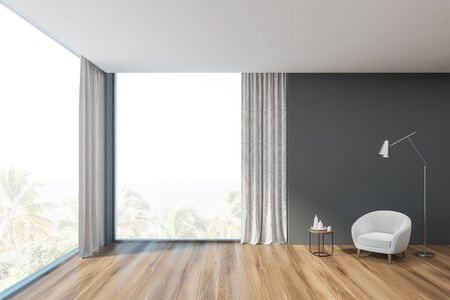 Interior of modern living room in minimalistic style with gray walls, panoramic windows, wooden floor and comfortable white armchair with floor lamp near it. 3d rendering