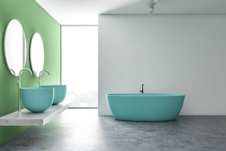 Interior of loft bathroom with white and green walls, concrete floor, massive blue double sink with round mirrors and comfortable blue bathtub. 3d rendering Stockfoto