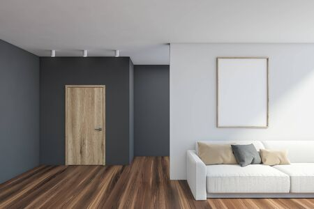 Interior of stylish living room with gray and white walls, wooden floor, comfortable white sofa and vertical mock up poster frame hanging above it. 3d rendering Stock fotó