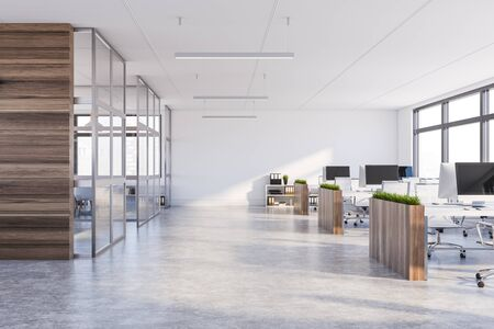 Interior of modern office with white walls, concrete floor, rows of computer tables with flower beds and panoramic windows. 3d rendering Фото со стока