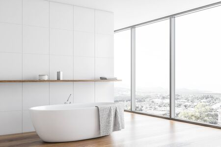 Corner of modern bathroom with white tile walls, wooden floor, panoramic window with beautiful view and comfortable bathtub with shelf above it. 3d rendering