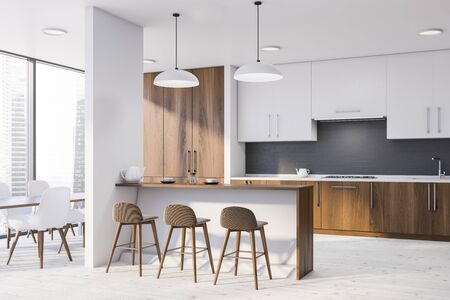 Corner of modern kitchen with white walls, wooden countertops, white cupboards, bar with stools and dining table with white chairs. 3d rendering