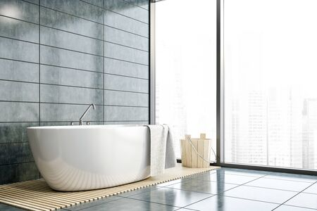 Corner of stylish bathroom with gray tile walls and floor, comfortable white bathtub and wooden bucket. Panoramic window with cityscape. Concept of spa. 3d rendering Stockfoto