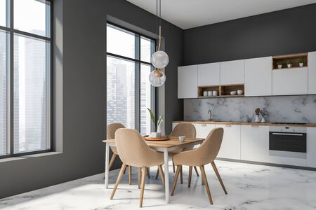 Corner of luxury kitchen with gray and white marble walls, marble floor, white countertops and cupboards and square wooden dining table with beige chairs. 3d rendering