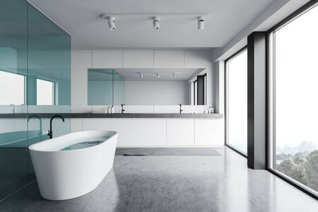 Interior of stylish bathroom with white and blue glass walls, concrete floor, panoramic windows, comfortable bathtub and double sink with horizontal mirror. 3d rendering Banco de Imagens
