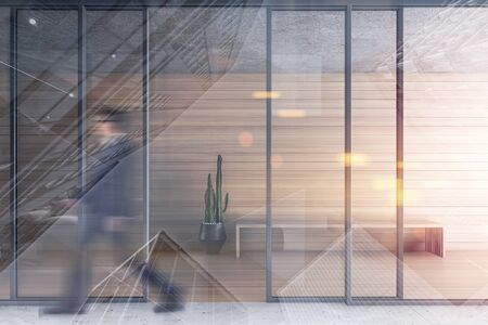 Blurry young businessman walking in modern living room corridor or office building with wooden and glass walls and bench with potted plant near it. Toned image double exposure Banque d'images - 131958455