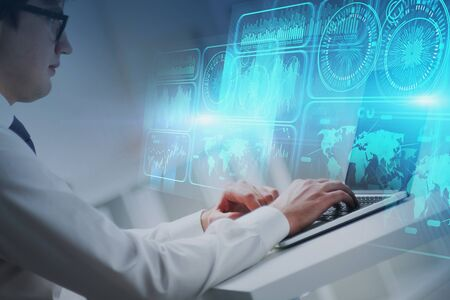 Handsome young businessman working with laptop in blurry office with double exposure of HUD digital interface. Concept of cloud computing and big data. Toned image