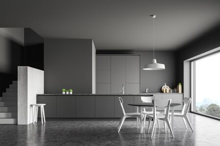 Interior of modern kitchen with gray walls, concrete floor, white stairs, grey countertops and bar and round dining table with chairs. 3d rendering