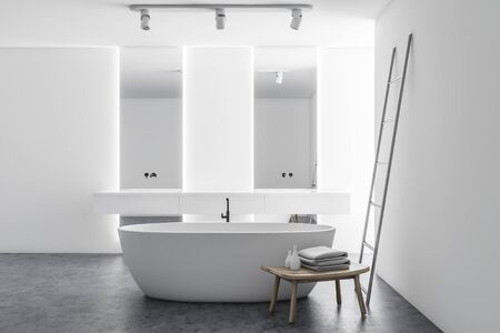 Interior of stylish bathroom with white walls, concrete floor, double sink with vertical mirrors, comfortable bathtub and melal ladder. 3d rendering Stockfoto
