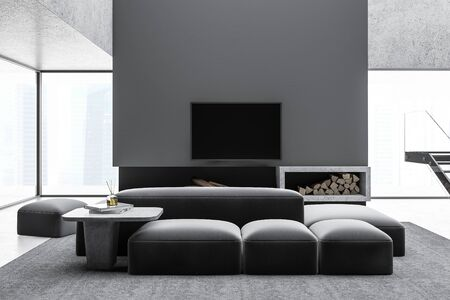 Interior of panoramic living room with gray walls, concrete floor, comfortable sofa and armchair near coffee table, flat screen TV above fireplace and stairs. 3d rendering