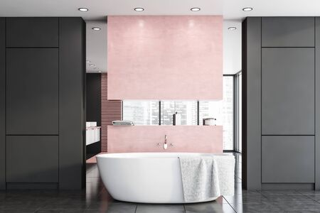 Interior of stylish bathroom with gray and pink walls, tiled floor, comfortable white bathtub with towel on it and mirror. 3d rendering Stockfoto