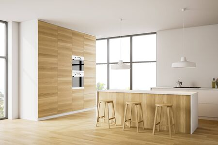 Corner of stylish kitchen with white walls, wooden floor, bar with wooden stools, white countertops and two built in ovens. 3d rendering