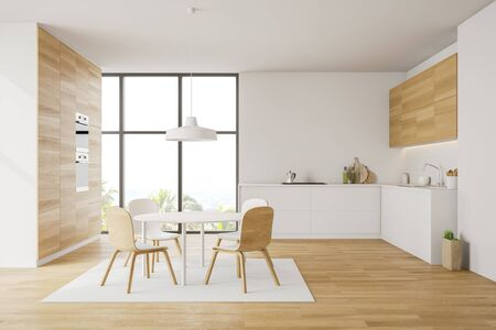 Interior of modern kitchen with white and wooden walls, wooden floor, comfortable white countertops, wooden cupboards and round dining table with chairs on carpet. 3d rendering Stock Photo