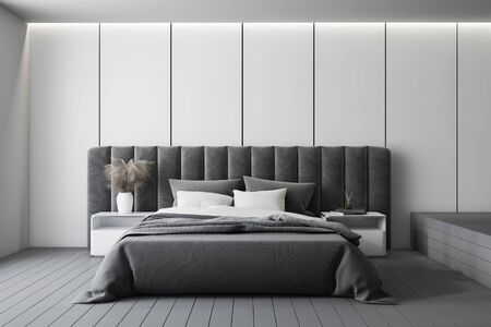 Interior of minimalistic master bedroom with white panel walls, gray floor, comfortable king size bed with two bedside tables and grey headboard. 3d rendering