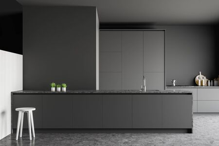 Close up of modern kitchen with gray walls, concrete floor, grey countertops, island with chair and panoramic window. 3d rendering