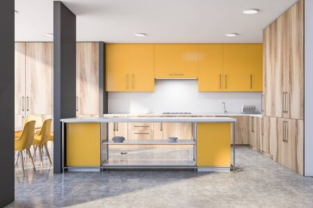 Interior of spacious kitchen with gray and white walls, wooden countertops, yellow cupboards, yellow island and dining table with chairs. 3d rendering