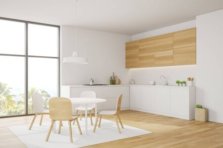 Corner of modern kitchen with white and wooden walls, wooden floor, comfortable white countertops, wooden cupboards and round dining table with chairs on carpet. 3d rendering Stock Photo