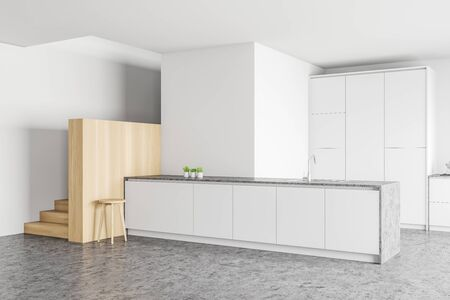 Corner of stylish kitchen with white and wooden walls, concrete floor, staircase and white island with built in sink. 3d rendering Stock Photo
