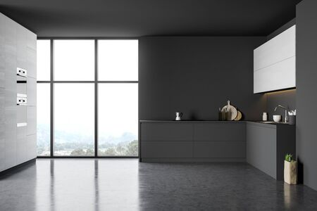 Interior of modern kitchen with gray and dark wooden walls, concrete floor, comfortable grey countertops, white cupboards and two built in ovens. 3d rendering