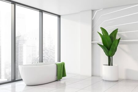 Corner of panoramic bathroom with white walls, tiled floor, comfortable bathtub with green towel hanging on it and big potted plant. 3d rendering Stock fotó