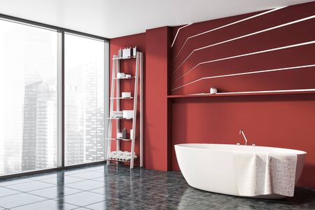 Corner of panoramic bathroom with red walls, gray tiled floor, comfortable bathtub with towel on it and shelves with beauty products. 3d rendering Stock fotó