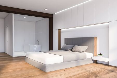 Corner of modern bedroom with white and brown walls, wooden floor, comfortable king size bed and bathroom with bathtub in background. 3d rendering Banco de Imagens