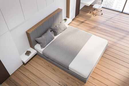 Top view of modern bedroom with white and brown walls, wooden floor, comfortable king size bed and home office with compact table and white chair. 3d rendering Banco de Imagens