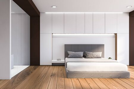 Interior of modern bedroom with white and brown walls, wooden floor, comfortable king size bed and bathroom with bathtub to the left. 3d rendering