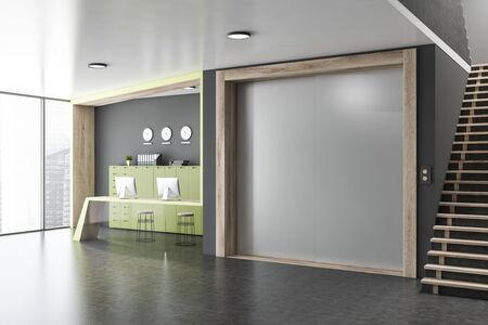 Interior of office elevator hall with grey walls, concrete floor, reception desk with two computers on it, modern elevator with closed doors and staircase. 3d rendering