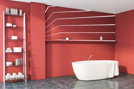 Corner of stylish bathroom with red walls, gray tiled floor, comfortable bathtub with towel on it and shelves with beauty products. 3d rendering