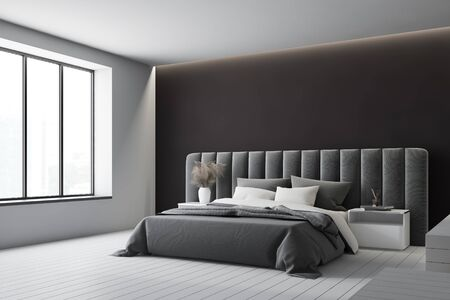 Corner of minimalistic master bedroom with white and black walls, comfortable king size bed with two bedside tables and soft gray headboard and big window. 3d rendering