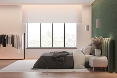 Side view of stylish master bedroom with green and pink walls, wooden floor, comfortable green king size bed with clothes hanging near it. 3d rendering