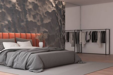 Corner of modern bedroom with crude gray and pink walls, wooden floor and comfortable orange king size bed and clothes hanging near it. 3d rendering