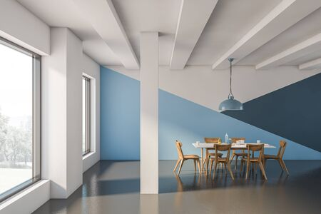 Interior of luxury industrial style dining room with white, blue and dark blue walls, concrete floor, columns, big windows and long white table with dark wooden chairs. 3d rendering Stock Photo