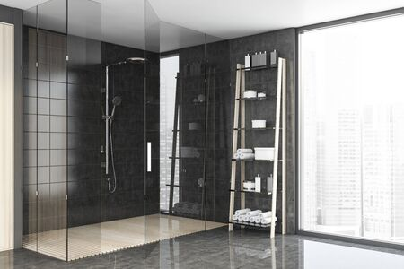 Corner of spacious bathroom with gray tile walls, concrete floor, comfortable shower stall and shelves with towels and creams near panoramic window. 3d rendering Stok Fotoğraf