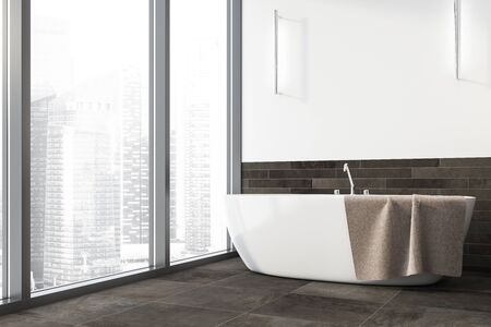 Interior of panoramic bathroom with white and grey tile walls, tiled floor, comfortable bathtub with towel on it and window with cityscape. 3d rendering