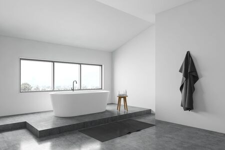 Corner of minimalistic bathroom with white walls, concrete floor, comfortable white bathtub under window and chair with towels. 3d rendering Stok Fotoğraf