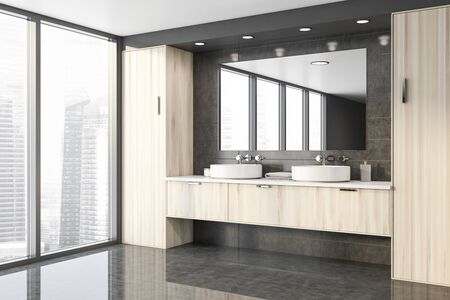 Corner of stylish panoramic bathroom with gray tile walls, concrete floor, double sink standing on wooden countertop and big mirror. 3d rendering