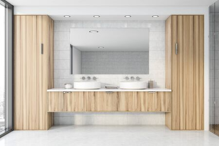Interior of stylish bathroom with white tile walls, concrete floor, double sink standing on wooden countertop and big mirror. 3d rendering Reklamní fotografie